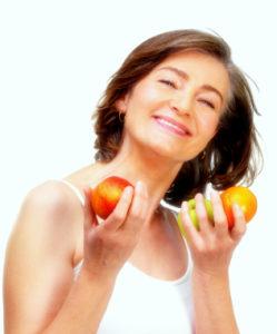 Mature woman holding fruit
